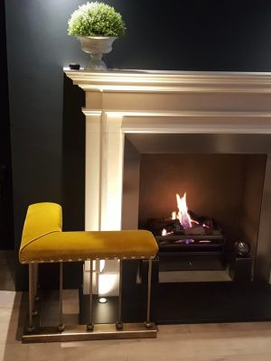 Gold Velvet fireplace seating with antique gold finish